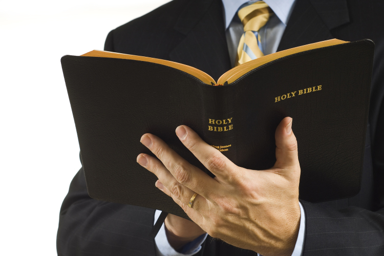 bigstock_preacher_with_bible_2744482-750x500